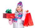 Happy woman with gifts after shopping to the new year smiling isolated on white Royalty Free Stock Photo