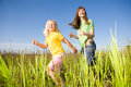 Happy woman and girl making exercises on field Royalty Free Stock Photography