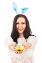 Happy woman give easter eggs with bunny ears giving yellow isolated on white background Stock Photos