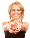 Happy woman giving gift box selective focus of young holding in hands little red isolated on white background christmas surprise Royalty Free Stock Photography