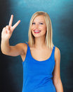 Happy woman giving peace sign Stock Images