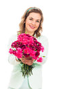 Happy woman giving pink flower Royalty Free Stock Images