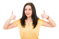 Happy woman giving thumbs in blank yellow t shirt isolated on white background Stock Image