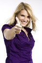 Happy woman giving a thumbs up sign enthusiastic blond of agreement amd approval upper body studio portrait on white Stock Image