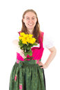 Happy woman giving you roses as present in dirndl Stock Image