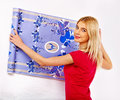 Happy woman glues wallpaper at home Royalty Free Stock Photography