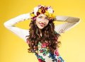Happy woman with hair made ​​of flowers brunette a chic hairstyle curly yellow background Royalty Free Stock Photo