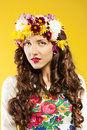 Happy woman with hair made ​​of flowers portrait of curly brunette studio yellow background Stock Photography