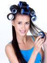 Happy woman in hairrollers Stock Image