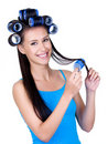 Happy woman with hairrollers Stock Images