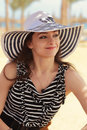 Happy woman in hat looking on summer background Stock Photo