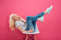 Happy woman having fun on the chair Royalty Free Stock Photo