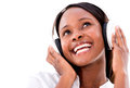 Happy woman with headphones listening to music isolated over white Stock Image