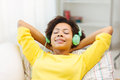Happy woman with headphones listening to music Royalty Free Stock Photo