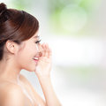 Happy woman with health skin talk to you attractive and teeth she is nature green background asian Stock Photo