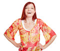 Happy woman with her arms akimbo best ager Royalty Free Stock Photo