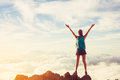 Happy Woman Hiker With Open Arms at Sunset on Mountain Peak Royalty Free Stock Photo