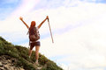 Happy woman hiker young hiking open arms to blue sky Royalty Free Stock Photos