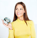 Happy woman holding alarm clock Stock Photo