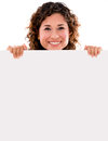 Happy woman holding banner ad isolated over white background Stock Photo