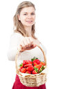Happy woman holding basket with strawberries Stock Photography