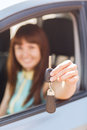 Happy woman holding car key vehicle rental automotive concept Royalty Free Stock Photos