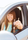 Happy woman holding car key vehicle rental automotive concept Royalty Free Stock Photography