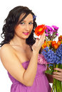 Happy woman holding flowers bouquet Royalty Free Stock Photography