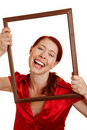 Happy woman holding frame Stock Photo