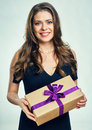 Happy woman holding gift box.