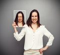 Happy woman holding her sad picture young Stock Images