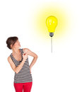 Happy woman holding a light bulb balloon young Royalty Free Stock Photography