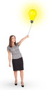Happy woman holding a light bulb balloon young Stock Photos