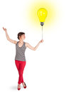 Happy woman holding a light bulb balloon young Stock Photography