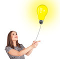 Happy woman holding a light bulb balloon young Stock Photo