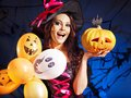 Happy woman holding pumkin and balloon. Royalty Free Stock Photo