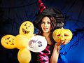 Happy woman holding pumpkin and balloon. Royalty Free Stock Photo