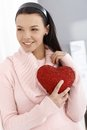 Happy woman holding red heart smiling Royalty Free Stock Images