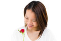 Happy woman holding red rose on white background Royalty Free Stock Photography