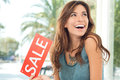 Happy Woman Holding Sale Sign Royalty Free Stock Images