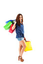 Happy woman holding shopping bags over her shoulder colorful on white background Royalty Free Stock Photo