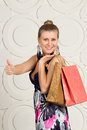 Happy woman holding shopping bags and smiling Royalty Free Stock Photo