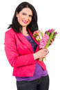 Happy woman holding spring flowers casual isolated on white background Royalty Free Stock Images