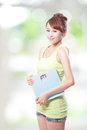 Happy woman holding a weight scale asian Stock Photo