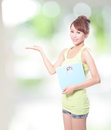Happy woman holding a weight scale and show copy space by hand asian Royalty Free Stock Photos
