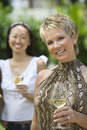Happy Woman Holding Wine Glass Stock Photos