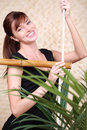 Happy woman holds on bamboo rope ladder Stock Images