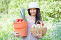 Happy woman holds vegetables harvest Royalty Free Stock Image