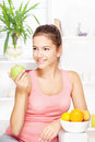 Happy woman at home with fruits Royalty Free Stock Photo