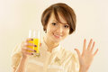 Happy woman with juice Royalty Free Stock Photos